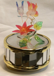 "RED & BLUE GLASS HUMMING BIRDS OVER RED FLOWER CAROUSEL PLAYS BEAUTY & THE BEAST  4"" X 4"" X 5 1/8"" HAND CRAFTED & HAND PAINTED"