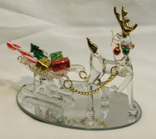 "GLASS REINDEER PULLING SLEIGH W/GIFTS ON MIRROR  22K GOLD TRIM 4 3/4"" X 3 1/4"" X4""  HAND CRAFTED & HAND PAINTED"