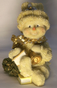 "FROSTED SNOWPERSON W/BELL, BOOKS & TREE  3 1/4"" X 2 1/2"" X 4 1/2"""