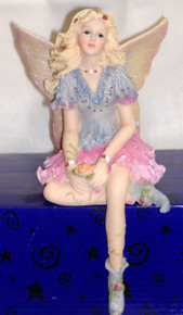 "PORCELAIN FAIRY SITTING ON SHELF IN BLUE AND PINK  3 7/8"" X 4 3/4"" X 7"" HAND CRAFTED & HAND PAINTED"