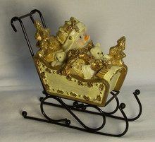 "SNOWBABY IN SLEIGH WITH METAL RUNNERS  5 3/8"" X 2 1/2"" X 4 1/2"""