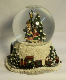 """MUSICAL SNOW GLOBE CAROLERS, SUROUNDED BY TOY TRAIN AT BASE PLAYS SANTA CLAUS IS COMING TO TOWN (3)  ONLY THREE LEFT  5"""" X 5 1/4"""" X 6 1/8"""""""