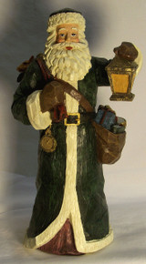 "SANTA IN LONG GREEN COAT W/LANTERN & BAGS OF TOYS (2) 5 1/4"" X 5 5/8"" X 10 1/4""  ONLY TWO LEFT"