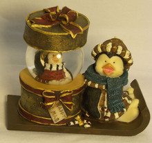 """PENGUIN ON SLEIGH WITH MINI SNOW GLOBE  (TOP COMES OFF HAT BOX)   4 1/4"""" X 2 3/8"""" X 3 3/4"""""""