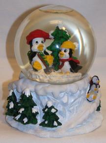 "MUSICAL SNOW GLOBE PENGUINS PLAYS WHITE CHRISTMAS MEASURES 5"" X 5"" X 5 3/4"""