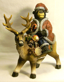 "SANTA BEAR RIDING REINDEER WITH GIFTS  MEASURES 8 1/4"" X 4 1/8"" X 9 3/4"" RESIN, ONLY 5 LEFT"