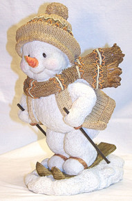 "SNOW PERSON SKIING FIGURINE MEASURES 4 7/8"" X 5 5/8"" X 8 5/8"""