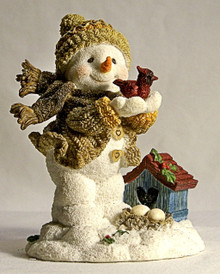 "SNOW PERSON WITH CARDINAL & BIRD HOUSE  MEASURES 3 5/8"" X 3"" X 4 3/8"""