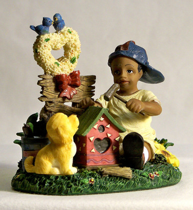 "AFRICAN AMERICAN LAD BUILDING BIRD HOUSE WITH PUPPY MEASURES 3 3/4"" X 2 5/8"" X 3 5/8"""