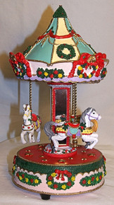 "MUSICAL HORSE CAROUSEL PLAYS WHITE CHRISTMAS  MEASURES 5 3/4"" X 5 3/4"" X 10 3/8"""