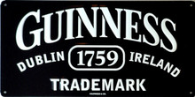 "GUINNESS TRADE MARK BLACK VINTAGE TIN SIGN.  HAS HOLES IN EACH CORNER FOR EASY MOUNTING, MEASURES 14"" X 7"""