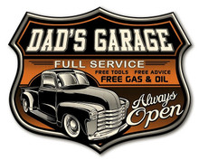"""DAD'S GARAGE SIGN MEASURES 12"""" X 15"""" X 5/8 IT IS A SHIELD SHAPED BIRCH WOOD PRINT."""