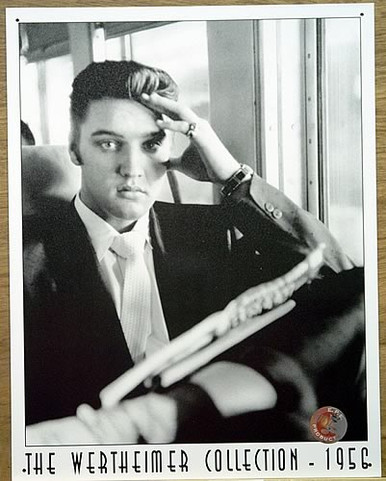 Photo of ELVIS GOING HOME BLACK AND WHITE SIGN SHOWS HIM RETURNING FROM THE ARMY ON A BUS