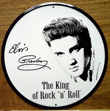 Photo of ELVIS ROUND SIGN WITH A COPY OF HIS SIGNATURE ON THE SIGN IS THE ONLY ROUND ELVIS SIGN IN STOCK, HOWEVER IT IS OUT OF PRINT WITH ONLY THREE LEFT