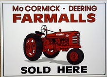 Photo of FARMALL SOLD HERE SIGN HAS A DOWN TO BUSINESS, NO FRILLS AD