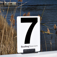 A Sculling Gear bow number, shown in standard rowing shell bow clip, ready to race. Rounded edges make insertion easier.