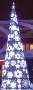 Moscow Snowflake Giant Tree.  This 21 foot tall giant tree has animated snowflakes that can be programed to eight different settings. This 21 foot tall giant tree has animated snowflakes that can be programed to eight different settings. There are various designs and sizes on the snowflakes built into the giant tree. These snowflakes are lit with white LED bulbs. The base of the tree is made of white polly webbing with white LED lights woven in.