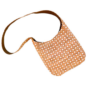 The Sling in Cork Dots.