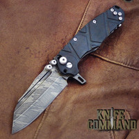 Wander Tactical Custom Mistral Ebony TI Extreme Duty Folding Knife Ice Brush.  Dark Ebony wood handles with polished hardware.