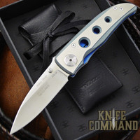 ATS-34 blade and brilliant blue titanium liner lock.