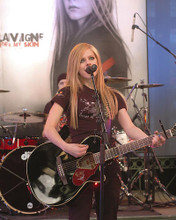 This is an image of 266055 Avril Lavigne Photograph & Poster