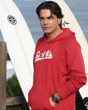 This is an image of 268107 Peter Gallagher Photograph & Poster
