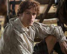 This is an image of Photograph & Poster of Sam Heughan 298229