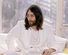 This is an image of Photograph & Poster of John Lennon 286868