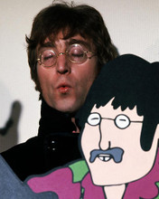 This is an image of Photograph & Poster of John Lennon 286921