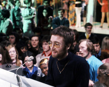 This is an image of Photograph & Poster of John Lennon 286927