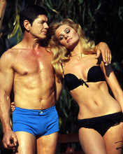 This is an image of Photograph & Poster of Charles Bronson and Jill Ireland 287142