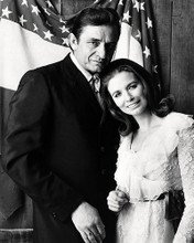 This is an image of Photograph & Poster of Johnny Cash and June 197650