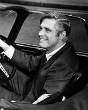 This is an image of Photograph & Poster of George Peppard 197537