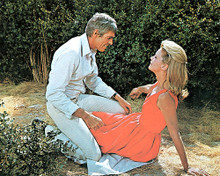 This is an image of 280838 James Coburn as John Cunningham and Lee Remick as Sheila Metcalfe in Hard Contract