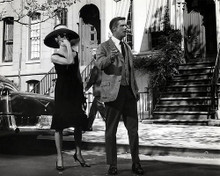 This is an image of 190691 Audrey Hepburn and George Peppard Photograph & Poster