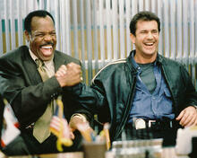 This is an image of 232936 Mel Gibson & Danny Glover Photograph & Poster