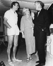 This is an image of 172285 Sean Connery, Shirley Eaton and Ian Fleming Photograph & Poster