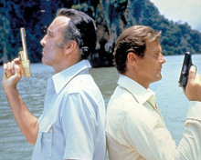 This is an image of 251714 Roger Moore and Christopher Lee Photograph & Poster