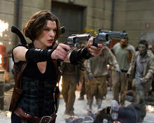 This is an image of 282640 Milla Jovovich Photograph & Poster