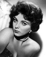 This is an image of Photograph & Poster of Joan Collins 102858