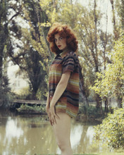 This is an image of Prints & Posters of Tina Louise 202223