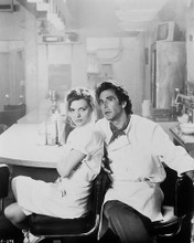 This is an image of 17028 Al Pacino & Michelle Pfeiffer Photograph & Poster