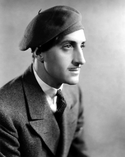 This is an image of Photograph & Poster of Basil Rathbone 101488