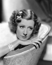 This is an image of Photograph & Poster of Irene Dunne 102739
