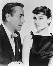 This is an image of 165622 Audrey Hepburn & Humphrey Bogart Photograph & Poster