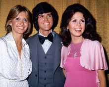This is an image of 265628 Olivia Newton-John, Marie & Donny Osmond Photograph & Poster