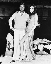 This is an image of 171681 Roger Moore & Valerie Leon Photograph & Poster