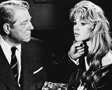 This is an image of 171637 Brigitte Bardot & Jean Gabin Photograph & Poster