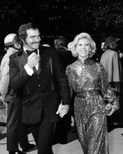 This is an image of 198365 Burt Reynolds and Dinah Shore Photograph & Poster