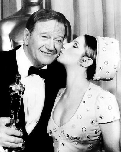 This is an image of 199844 John Wayne and Barbra Streisand Photograph & Poster